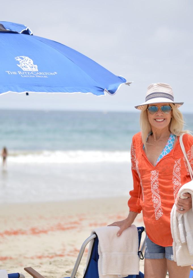 Laguna Beach, summer travel, summer destinations, Ritz-Carlton Laguna Nigel, orange boho cover-up, straw fedora, striped beach bag, Trina Turk swim