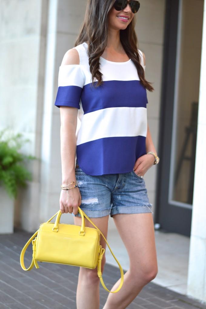 Yellow handbag, mini handbag, Saint Laurent handbag, accent accessory, navy and white striped top