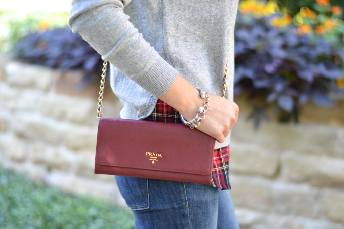 layered sweater, prada cross body bag, red crossbody bag, wallet on a chain