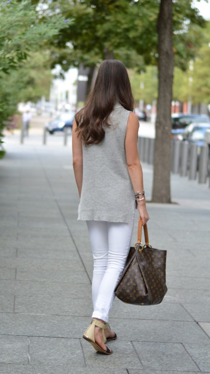 long length sleeveless sweater, white jeans for fall