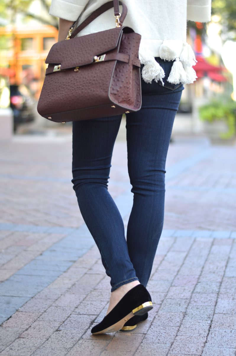 wine colored handbag, ostrich satchel, sweater with tassels