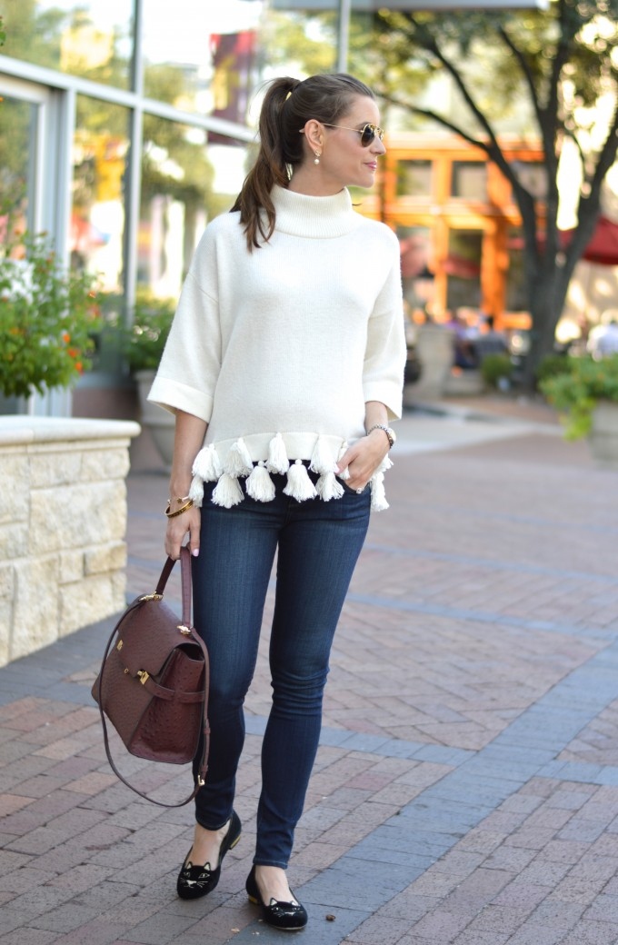 casual maternity style, weekend uniform, wine colored handbag, sweater with tassels