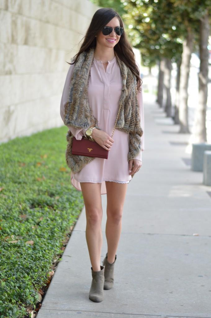 wearing a fur vest over a dress, blush pink dress with fur vest