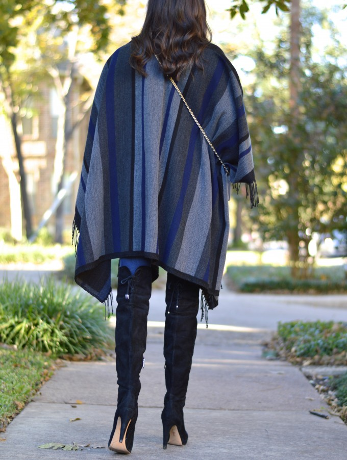 striped poncho, fringed poncho, over the knee boots