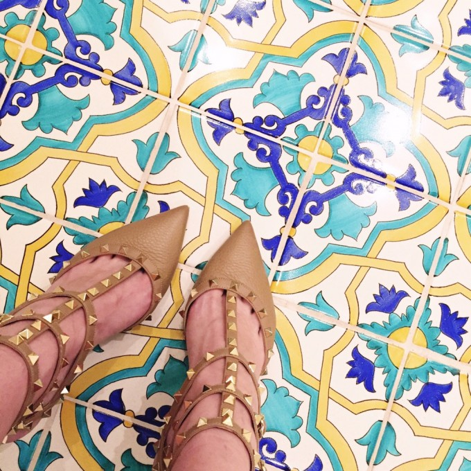 spanish tiled bathroom floor, valentino rock studs
