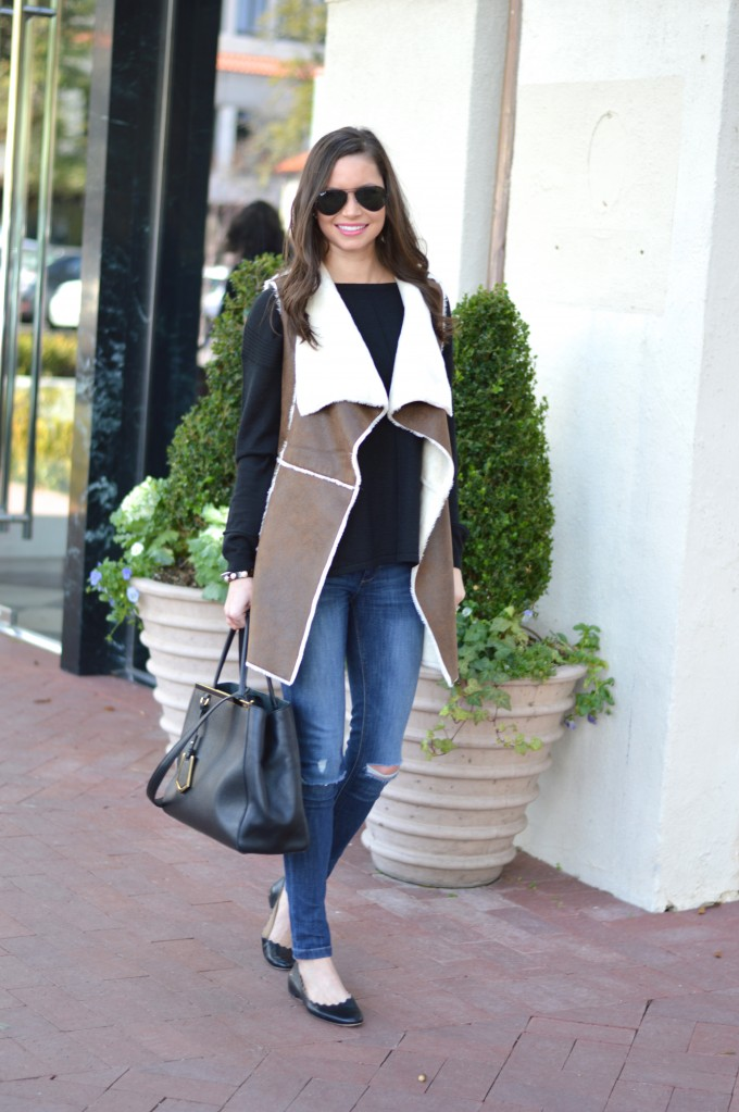 shearling vest, casual weekend style, distressed jeans, black sweater, fendi 2jours handbag