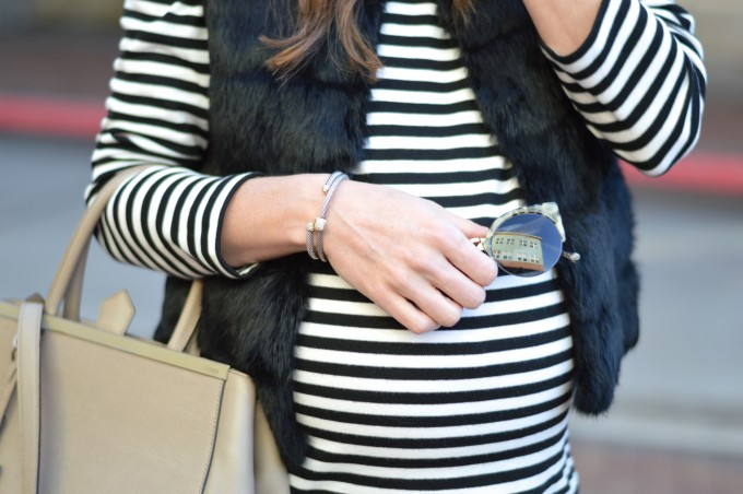 striped top, black fur vest, fendi 2jours handbag, prada sunglasses