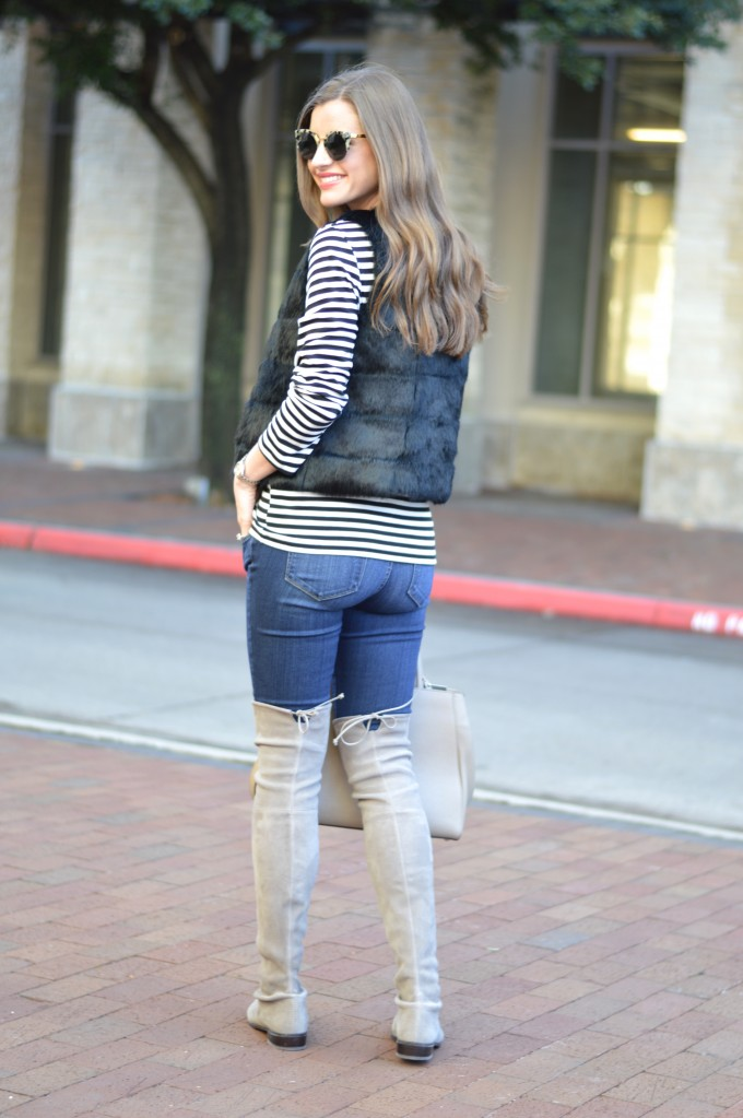 striped top, black fur vest,