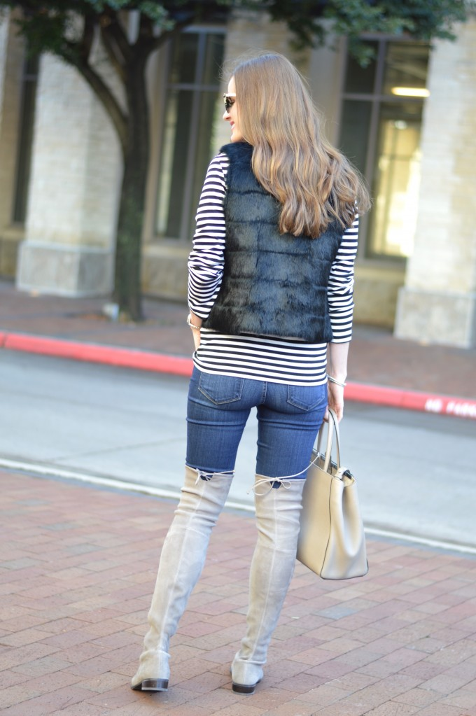 striped top, black fur vest, how to style a striped top, grey over the knee boots