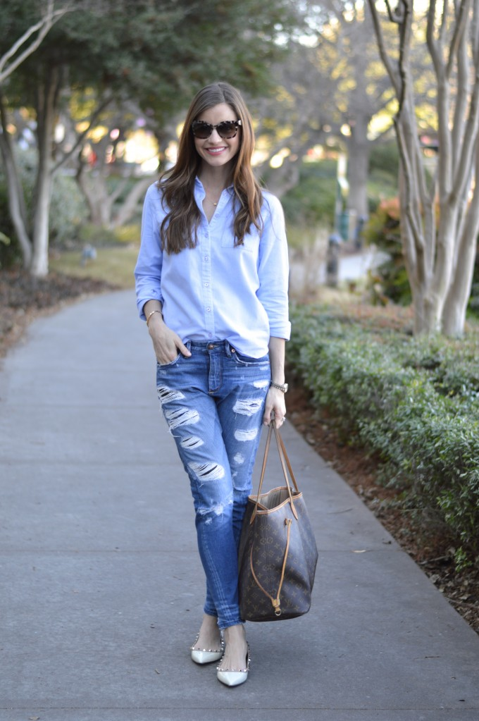 casual mom style, distressed jeans, blue button down shirt, designer diaper bag, valentino rockstud flats