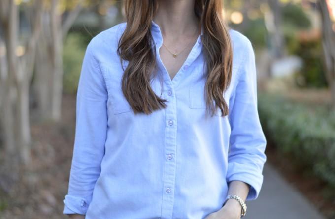blue button down shirt, gold monogram necklace