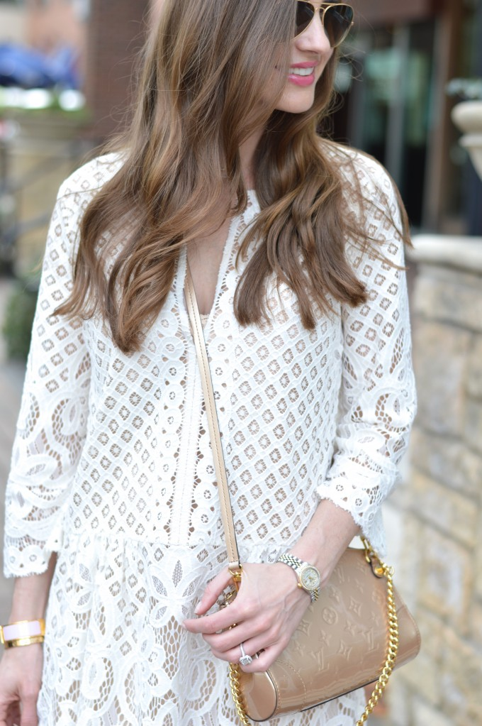 white lace dress, gold cross body bag