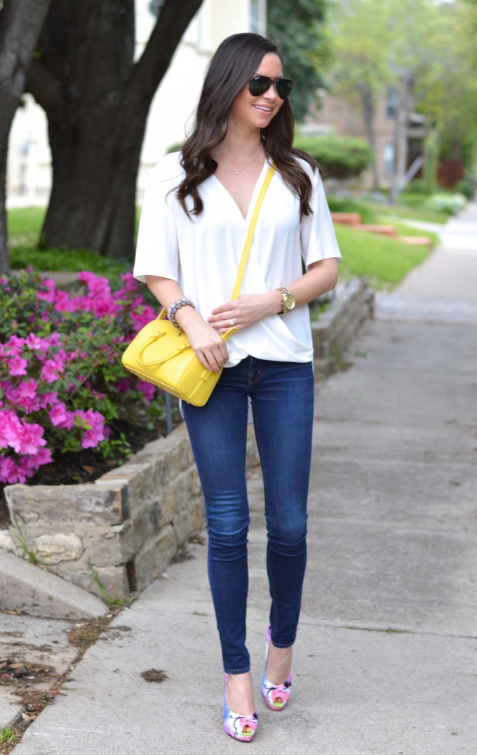 white drape front top, floral pumps, yellow cross body bag