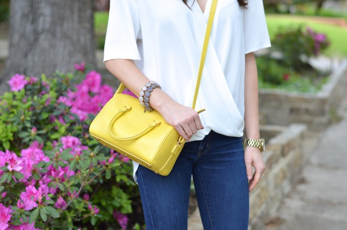yellow cross body bag, white drape front top