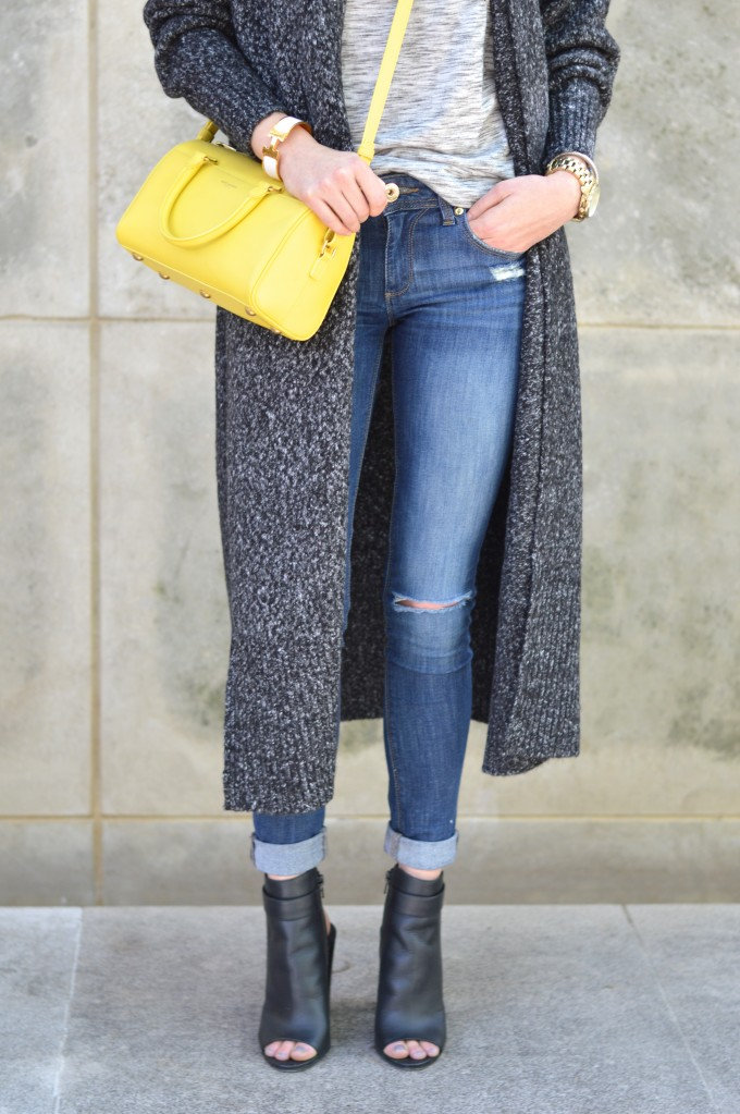 yellow cross body bag, distressed jeans, spring booties, long cardigan