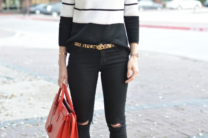 leopard print belt, black distressed jeans, red handbag, striped spring sweater