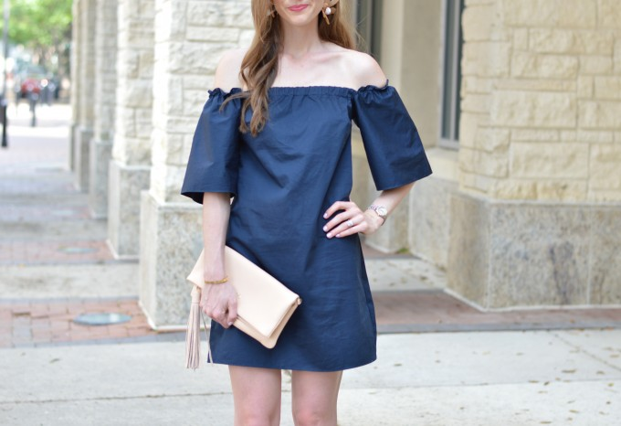 navy blue off the shoulder dress, nude clutch, statement earrings
