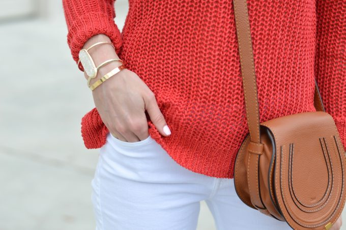 red sweater, statement bracelet, chloe cross body bag