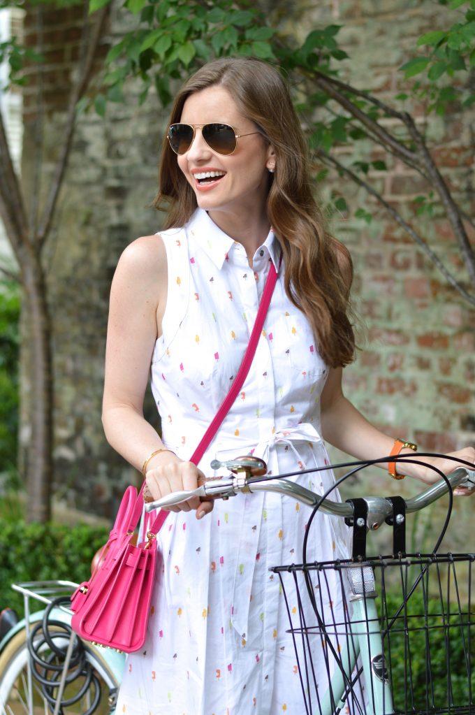 charlseton travel guide, white shirtdress, hot pink cross body bag,