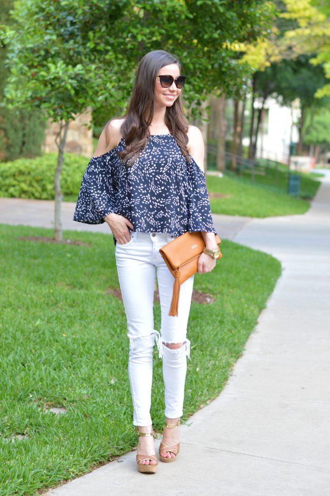 cold shoulder top, distressed white jeans, luggage wedges, cognac folder clutch