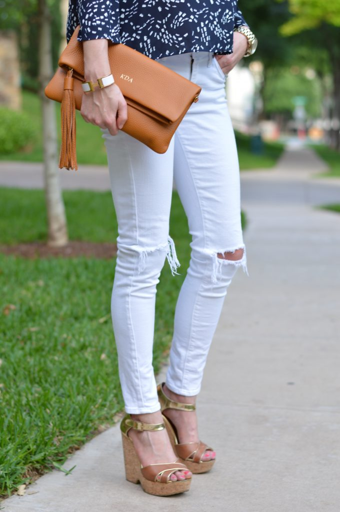 monogrammed foldover clutch, cognac clutch, distressed white jeans