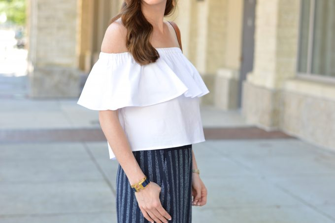 white ruffled off the shoulder top, loose waves