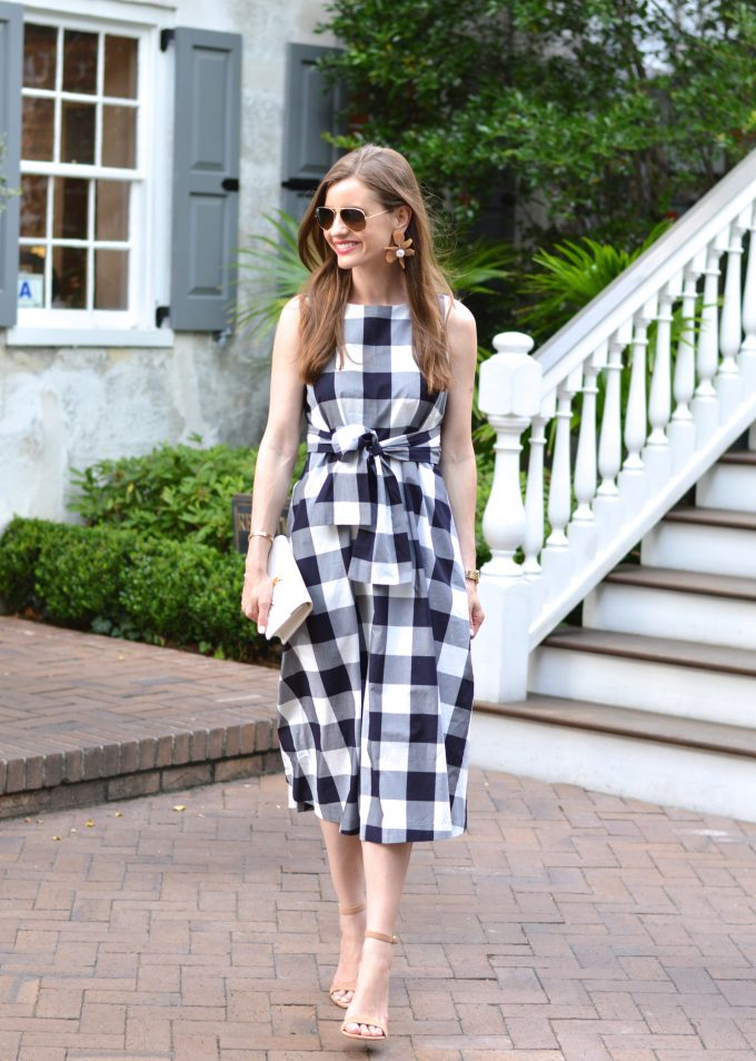 white clutch, blue and white gingham dress