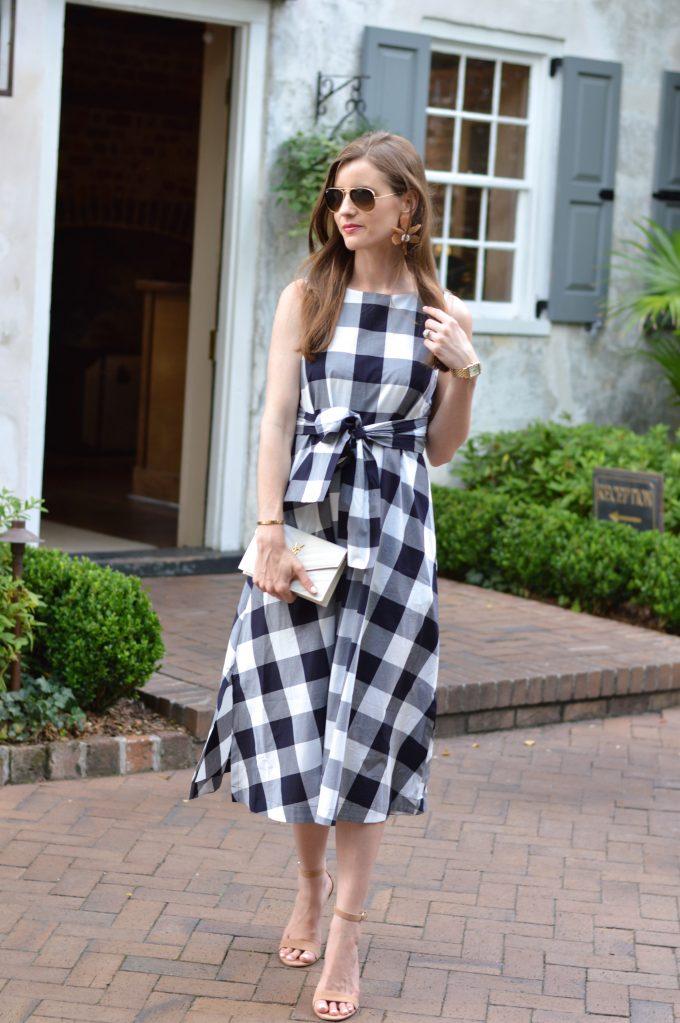 white clutch, blue dn. white checked dress