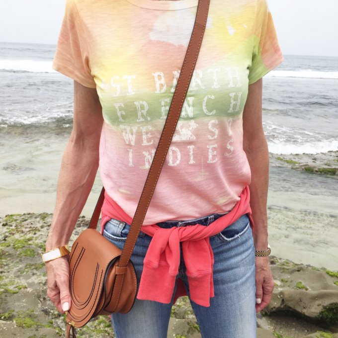graphic tee, tie dye graphic t-shirt, cognac cross body bag, coral sweatshirt