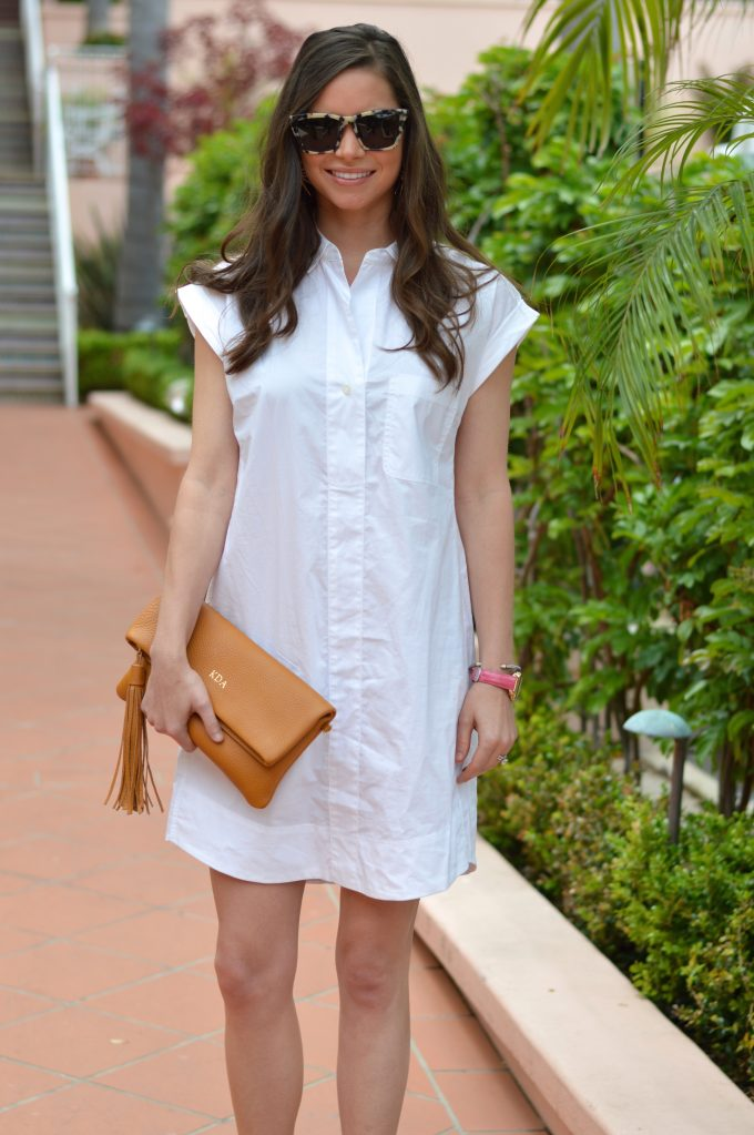 white shirtdress, nude platform sandals, brown clutch with tassel