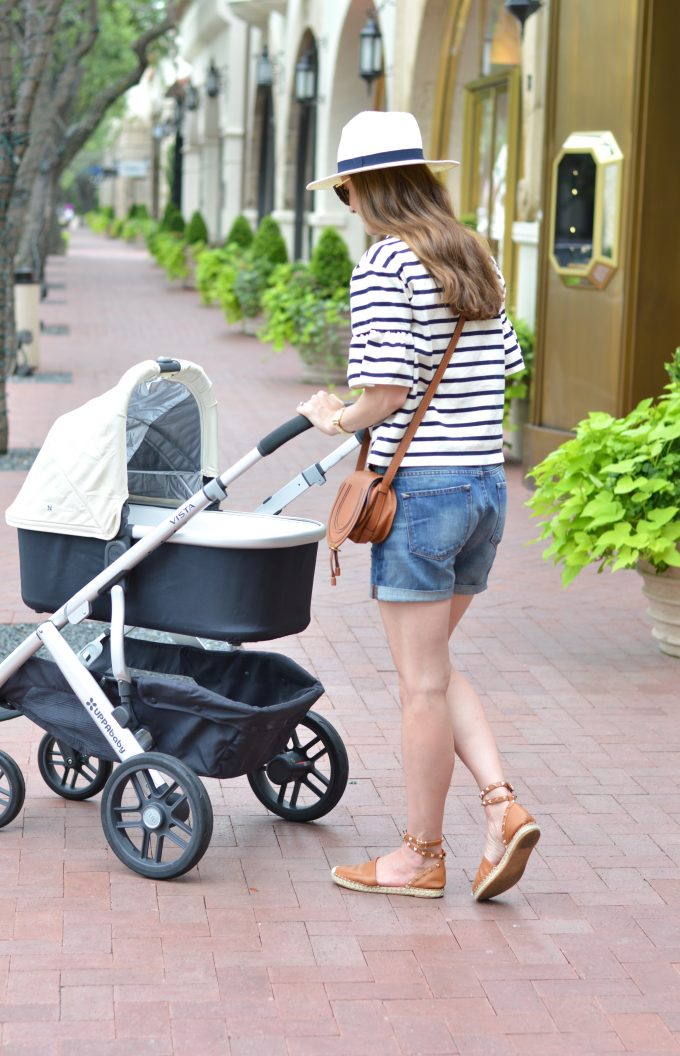 cream colored baby stroller, distressed denim shorts, rock stud espadrilles,