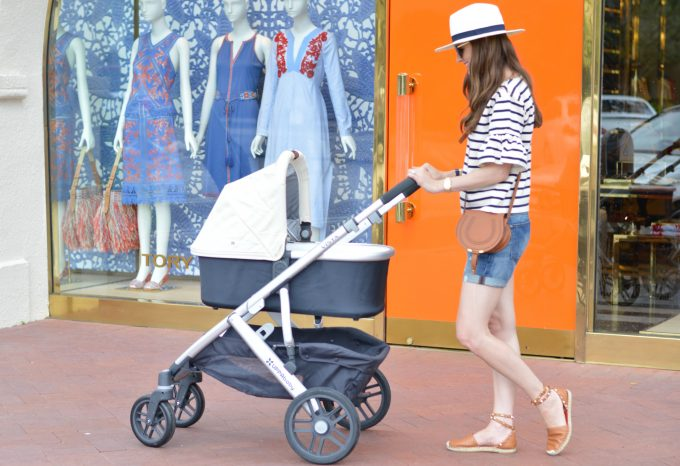 cream colored baby stroller, white fedora, cognac espadrilles, striped top