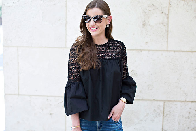 A darling boho top in black poplin with bell sleeves and with crochet detailing at the neck and upper sleeves