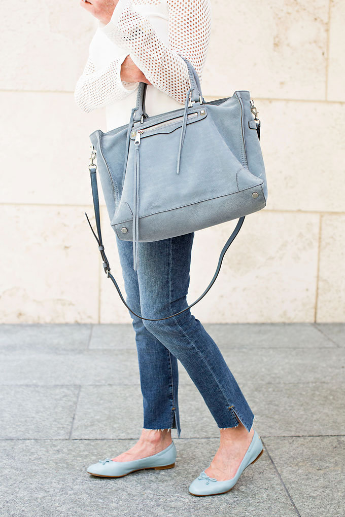 A beautiful soft blue suede handbag worn with a notched ankle jean and baby blue leather ballet flats