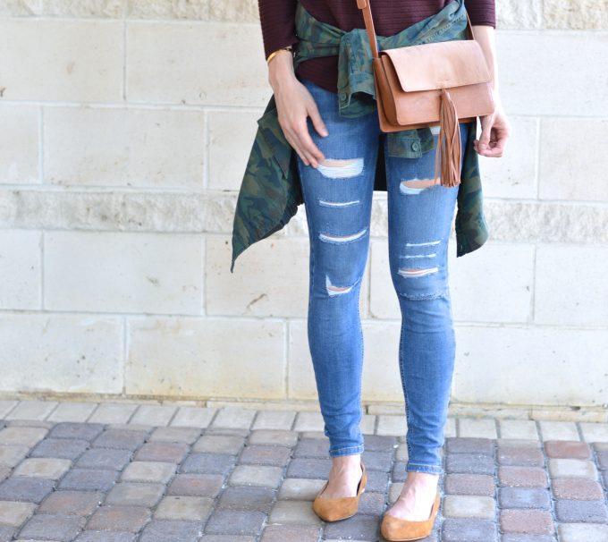 distressed jeans, saddle crossbody, camo jacket