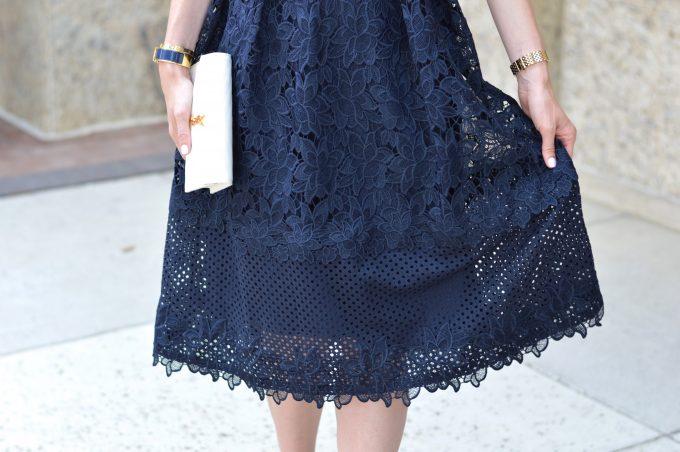 navy lace midi dress, white clutch