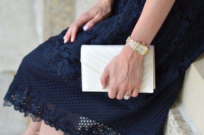 ladies gold watch, white clutch