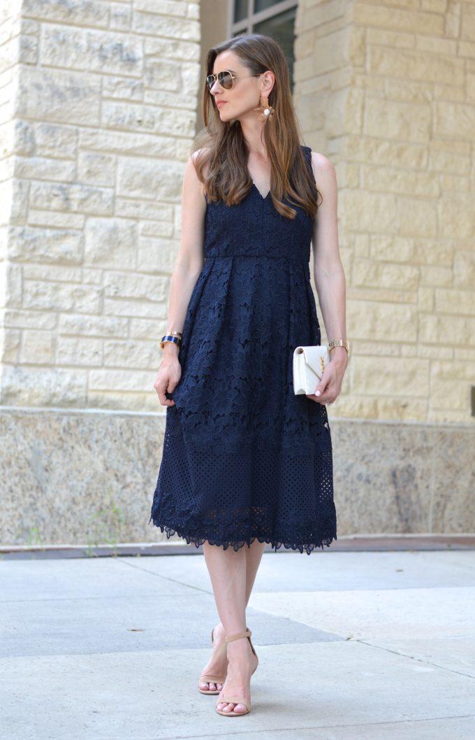 navy lace dress, navy midi dress, white clutch