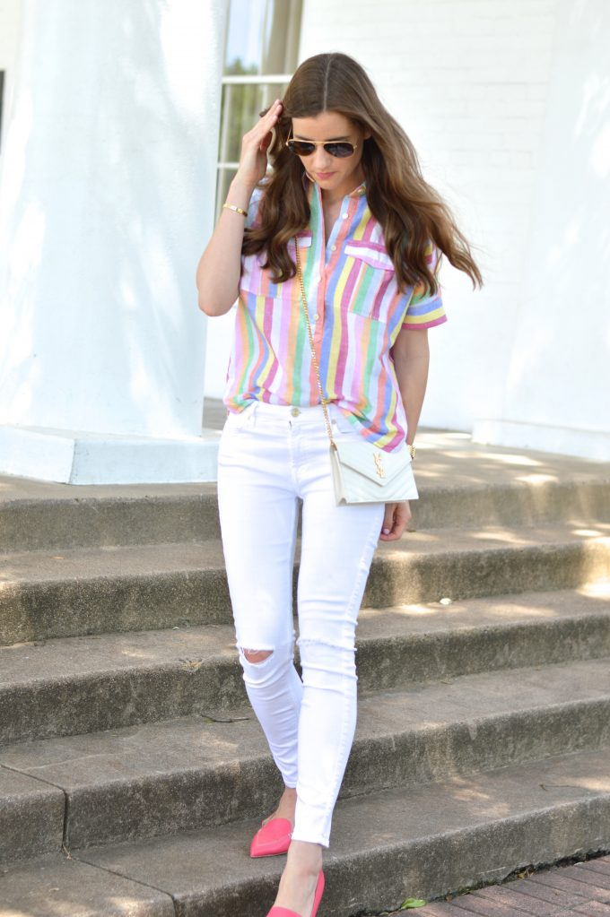 bishop and holland wearing a J. Crew rainbow striped shirt with white distressed jeans and hot pink loafers