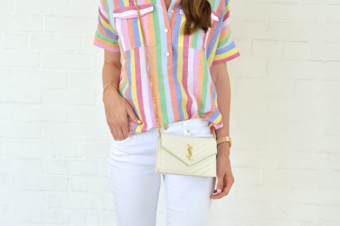 J. Crew rainbow stripe shirt with white cross body bag and white jeans