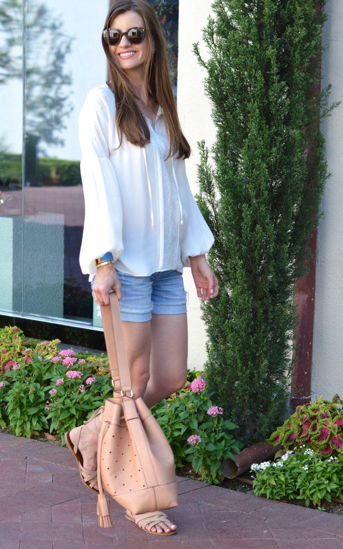 tan bucket bag, distressed boyfriend shorts