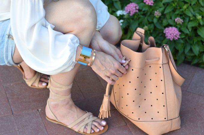 romantic top, hermès bracelet, ankle wrap sandals, tan bucket bag