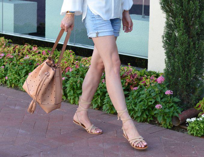 ankle wrap sandals, tan bucket bag, distressed boyfriend shorts