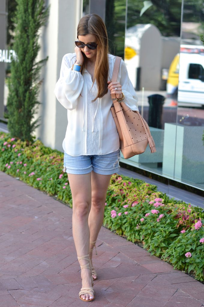 romanitc top with distressed boyfriend shorts and ankle wrap suede sandals