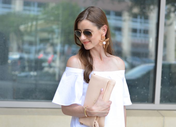 statement earrings, tassel clutch, neutral clutch