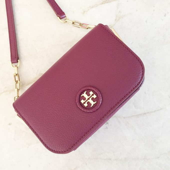 a crossbody bag in ox blood red