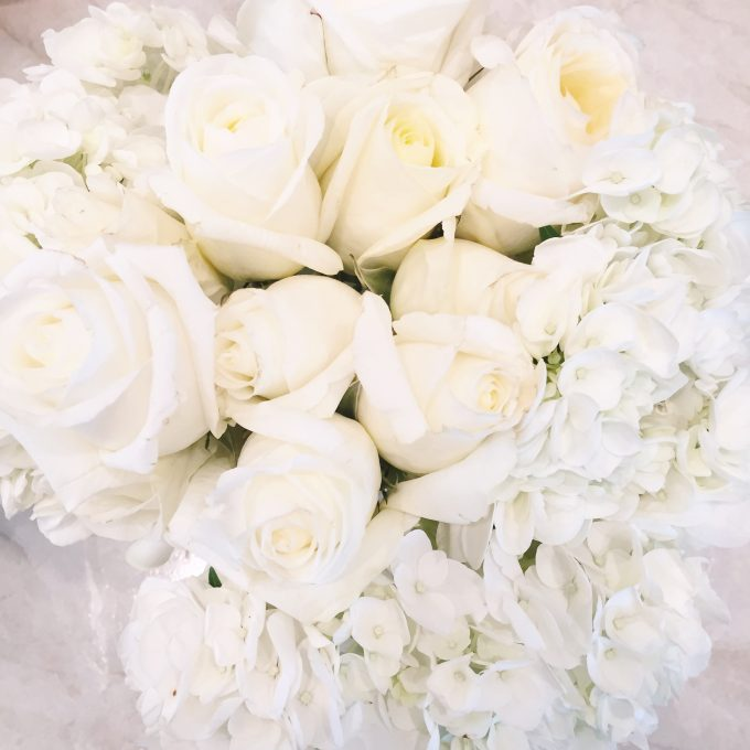 A beautiful arrangement of white roses and white hydrangeas