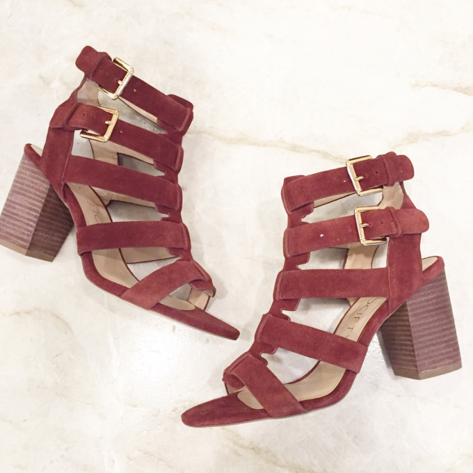 A pair of strappy heeled sandals in burgundy suede