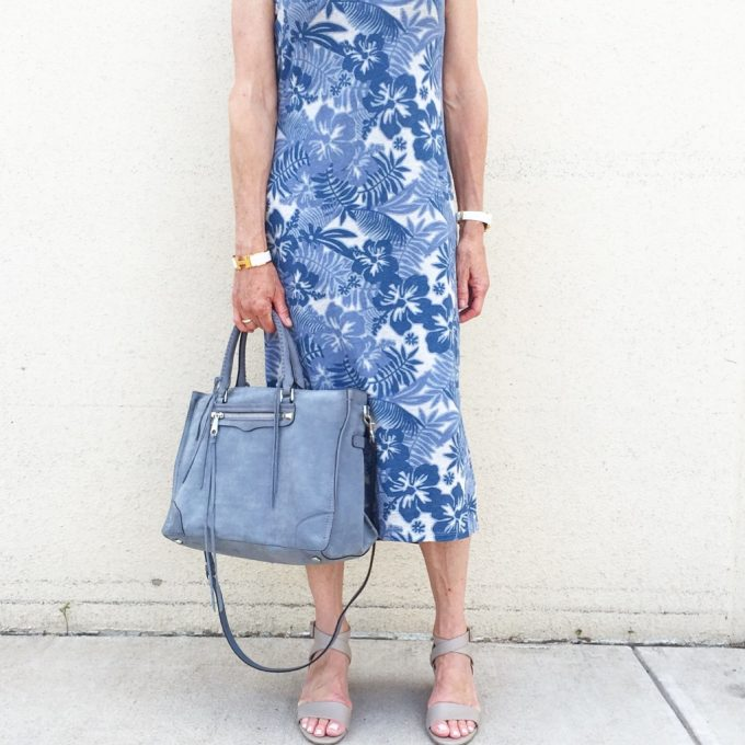 A tropical print maxi dress with baby blue suede handbag and block-heeled sandals