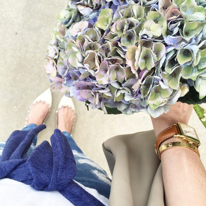 A bouquet of antique hydrangeas, ladies watch with brown strap and rockstud flats